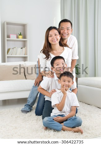 indoor portrait of asian family  - stock photo