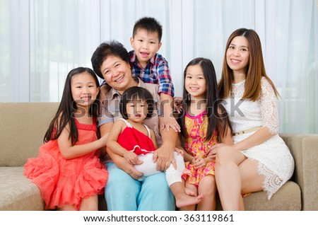Indoor portrait of asian senior woman together with her daughter and grandchildren - stock photo