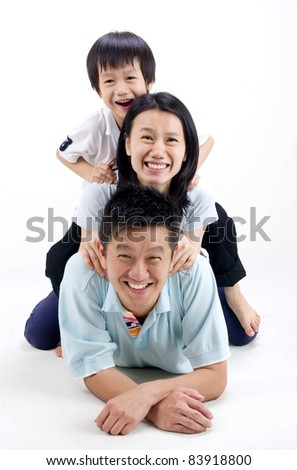 Indoor portrait of beautiful asian family - stock photo