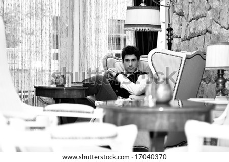 indoor portrait of young and happy  businessman - stock photo