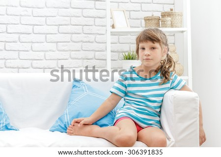indoor portrait of young happy smiing child girl at home - stock photo