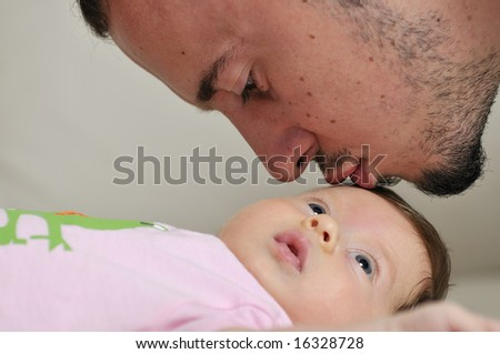 indoor portrait with happy young famil and  cute little babby - stock photo