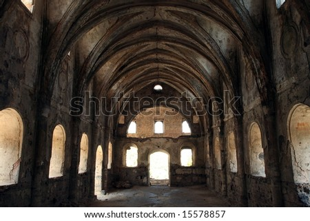 indoor shot of a church in ruins - stock photo