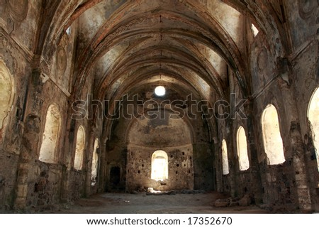 indoor shot of a church in ruins