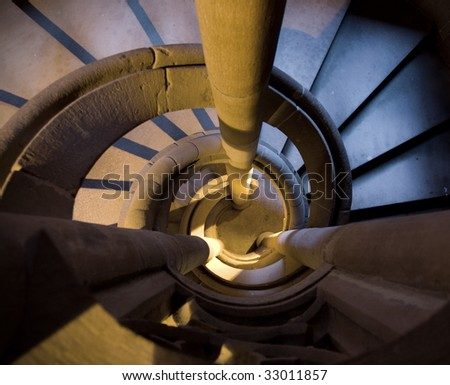 indoor shot of ancient spiral stairs - stock photo