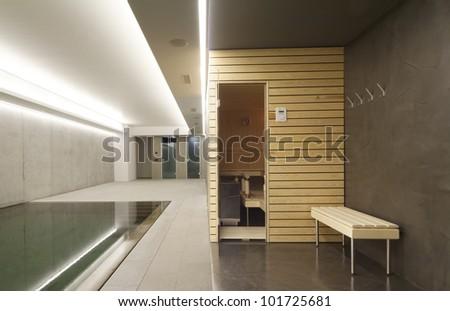 Indoor swimming pool with sauna - stock photo
