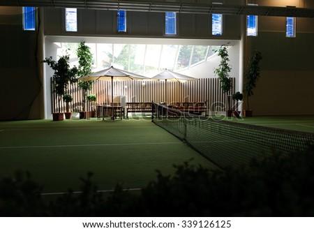 Indoor tennis court - stock photo
