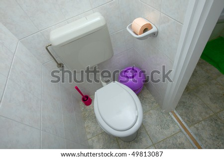 Indoor toilet of a residential building - stock photo