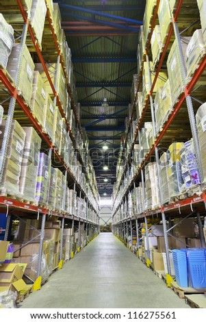 Indoor warehouse with lot of pallet. Wide angle photo. - stock photo