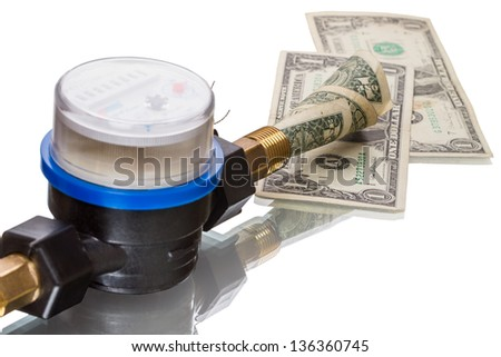 Indoor water meters used for measuring consumption of water in buildings / houses. - stock photo