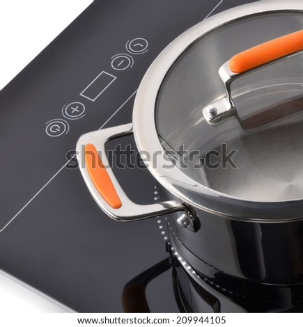 Induction stove, pot metal on it. - stock photo