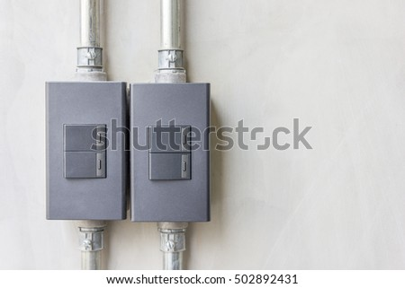 industrail and loft switch case style and metal wire pipes on the concrete wall