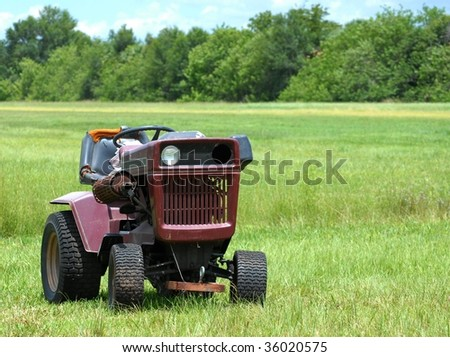 industrial agricultural scene of abandoned old rusted and dusty tractor in an empty field