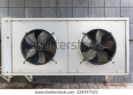 industrial air conditioner outdoor unit with two fans closeup - stock photo