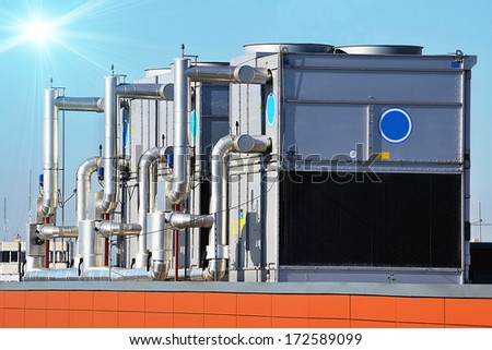 Industrial air conditioning unit cooling system on the roof of a building - stock photo