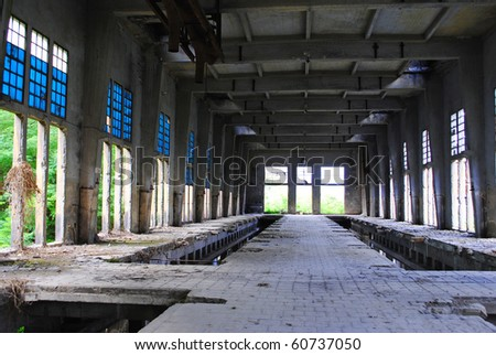 industrial archeology abandoned factory with long disused warehouses - stock photo