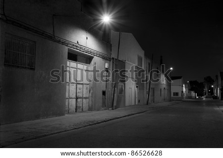 Industrial area at night - stock photo