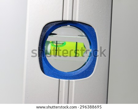 Industrial background from close up of spirit level. Precision tool for craftmens. Measurement and production. - stock photo