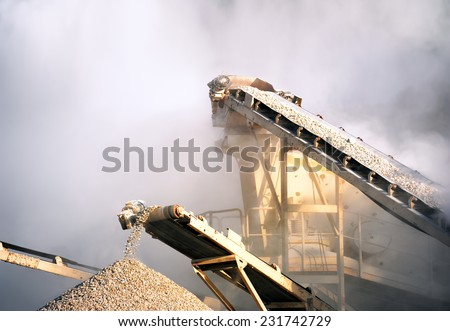 Industrial background of heavy machinery working on construction site  - stock photo