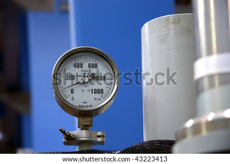 Industrial barometer on the machine - stock photo