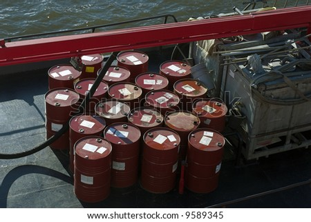 Industrial barrels stored outside on ship deck - stock photo