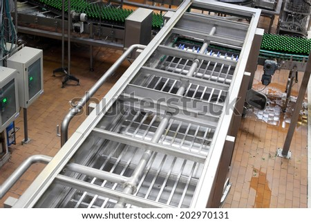 industrial beer factory with mechanisms - stock photo