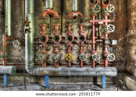 Industrial boiler room in a derelict factory, HDR - stock photo