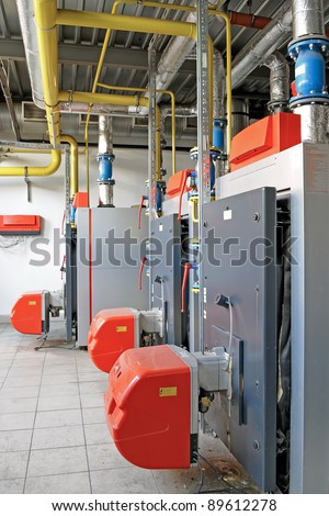 Industrial boiler room with gas boilers - stock photo