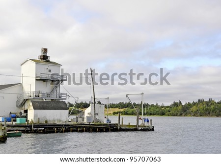 industrial building at Fisherman's Cove a 200 year old active fishing village on the shore of the Atlantic Ocean in Eastern Passage, near Halifax Nova Scotia - stock photo