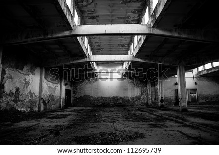 Industrial building interior in dark colors - stock photo