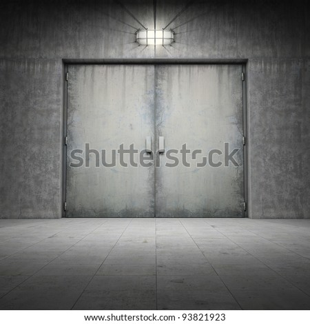 Industrial building made of grungy concrete with door - stock photo