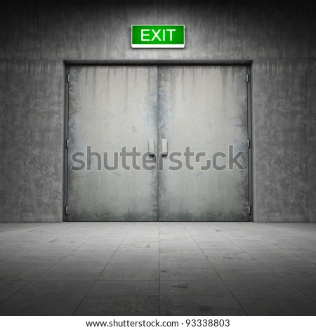 Industrial building made of grungy concrete with exit door - stock photo