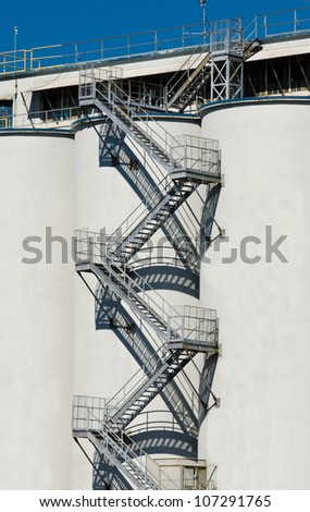 Industrial building, tower ( construction ) with the metal staircases, ladder segments - stock photo