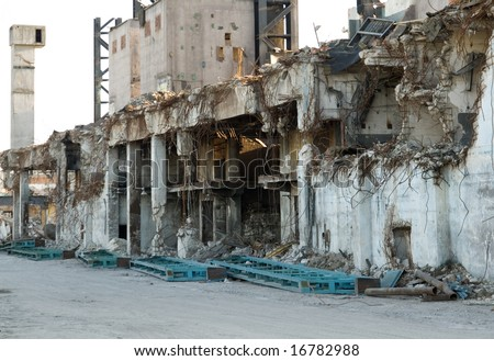 Industrial building under demolition - stock photo