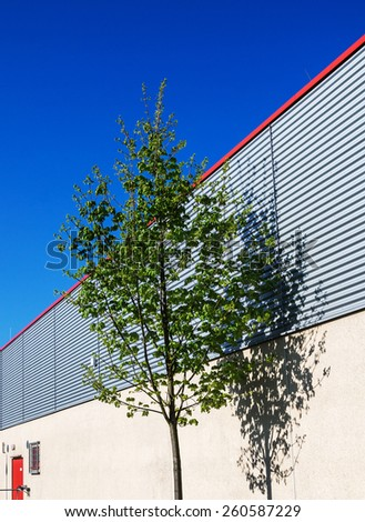 industrial building with tree - stock photo
