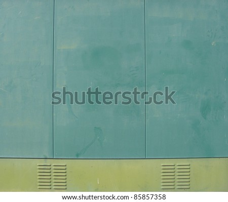 industrial cabin with green metal side panels and ventilation outlet - stock photo