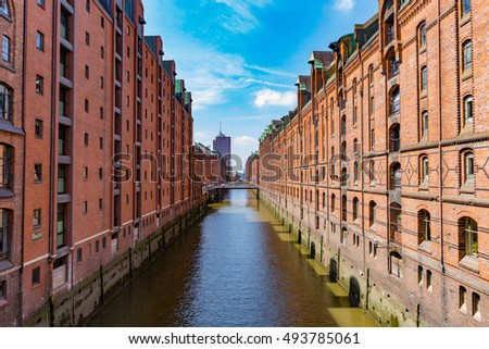 Industrial Canal in the Speicherstadt Hamburg. The buildings are of red brick. Hamburg, Germany