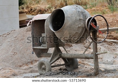 Industrial cement mixer machine at construction site. - stock photo