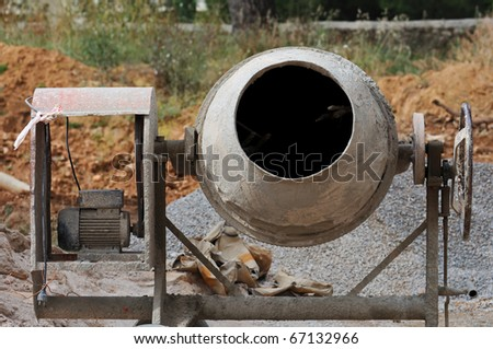 Industrial cement mixer machinery at construction site. - stock photo