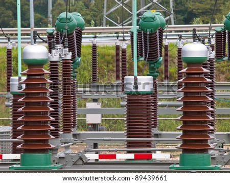 Industrial ceramic insulators on a high power transformation site - stock photo