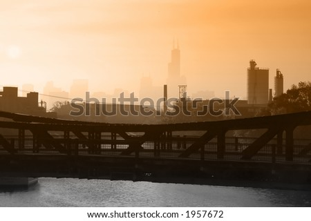 Industrial Chicago foggy skyline with steel draw bridge in foreground - stock photo