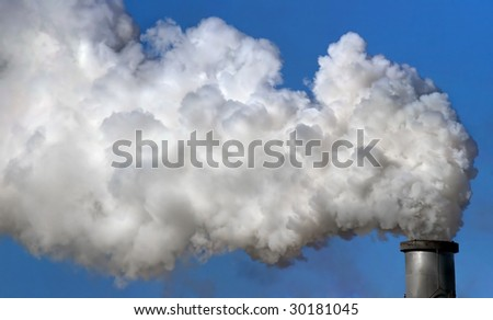 Industrial chimney exhausting smokes into the atmosphere. - stock photo