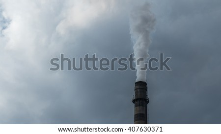 Industrial chimney fume mix in clouds - stock photo