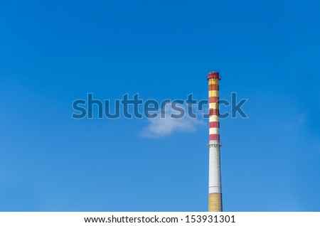 Industrial chimney. Red and white Chimney detail from paper factory - stock photo