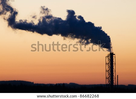 Industrial chimney with big smoke tail - stock photo