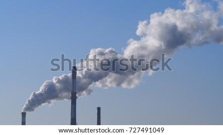 Industrial chimneys on blue sky