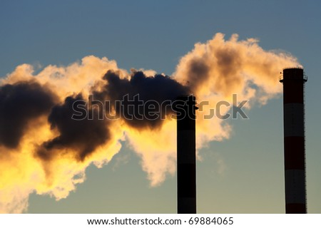 Industrial chimneys polluting environment with toxic smoke - stock photo