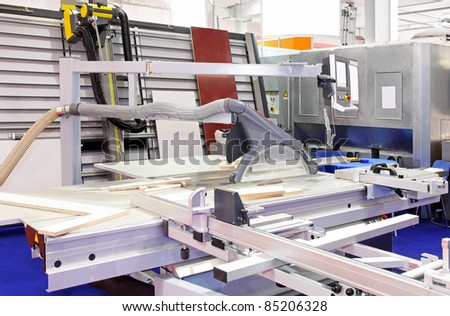 Industrial circular saw and vertical cutter in workshop