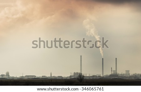 Industrial cityscape with coal power plant and smoke stacks - stock photo