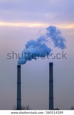 Industrial cityscape with coal power plant and smoke stacks